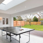 Recreation room with bi fold door system