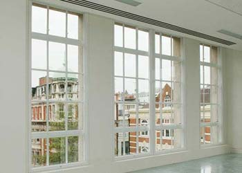 Vertical sliding secondary glazing shaws
