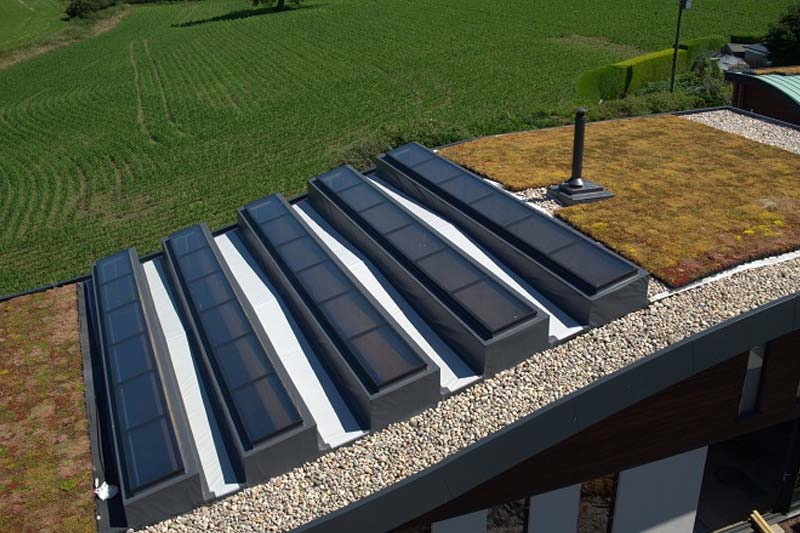 High performance fixed flat roof lights