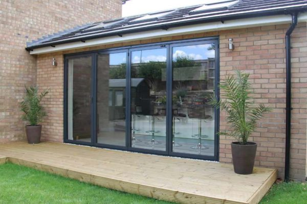 Sunflex bi folding door sf55 closed, leading out on to decking