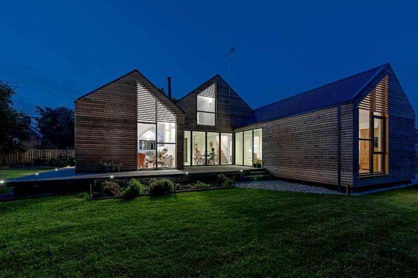 Sunflex bi folding door sf55 on modern wooden home at night