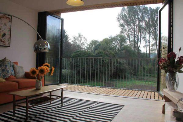 Sunflex bi folding door sf75 open out onto balcony