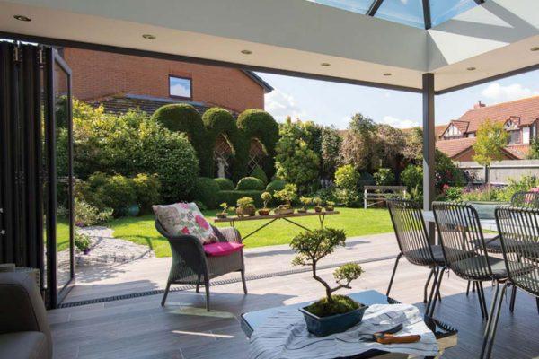 Large conservatory view of summer garden ob 49 origin door open Origin