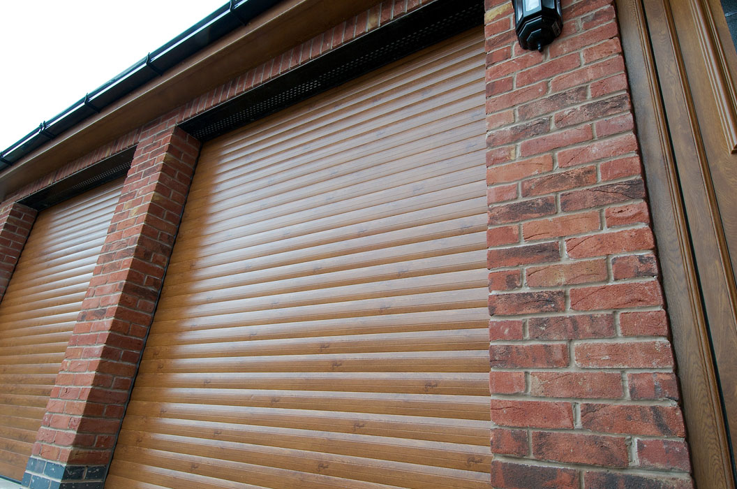 Closeup golden oak garage doors title=