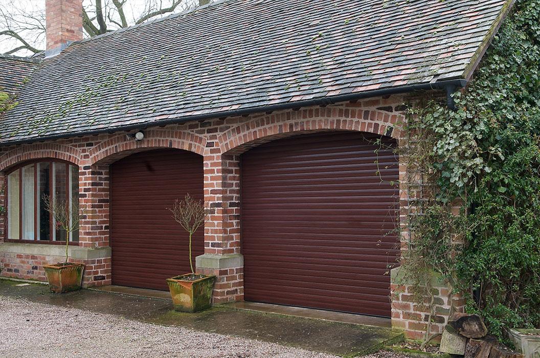 Roller shutter doors in rosewood title=
