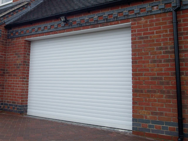 White remote controlled roller garage door title=